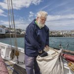 Cornish smock on boat with large canvas bag